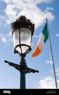 Decorative traditional street lamp and Irish flag flapping ...