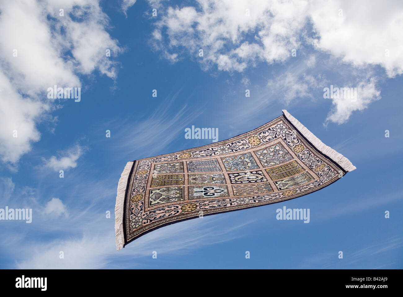 Frau Fliegender Teppich Magic Carpet Flying Across Blue Sky With White Clouds