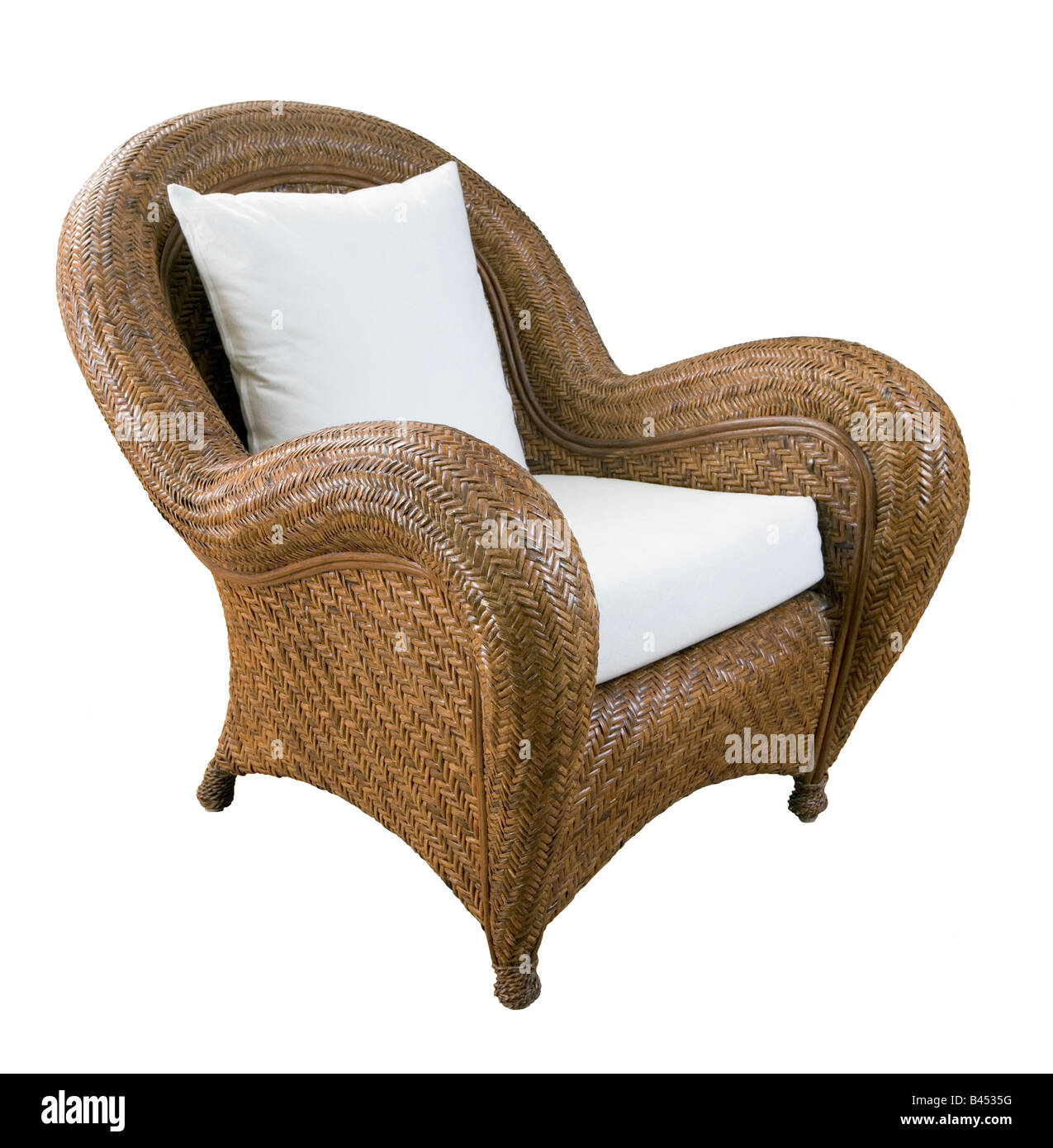A large wicker chair with white cushions Stock Photo