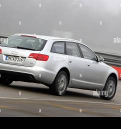 audi a6 avant 4 2 quattro model year 2005 silver driving diagonal from the back rear view test track [ 1300 x 956 Pixel ]