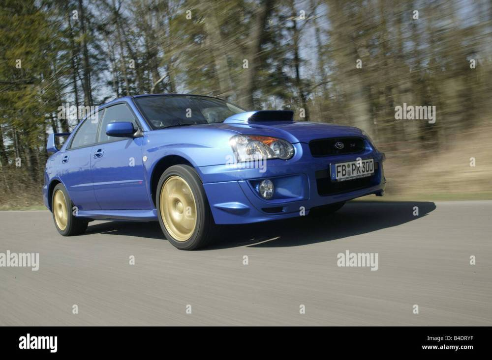 medium resolution of car subaru impreza wrx sti limousine coupe lower middle sized class model year 2003 blue moving country road diagonal f
