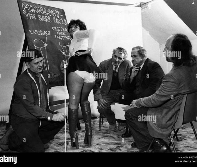 Woman Wearing A Mini Skirt Showing Off Her Knickers To A Group Of Men Circa 1966 P010051