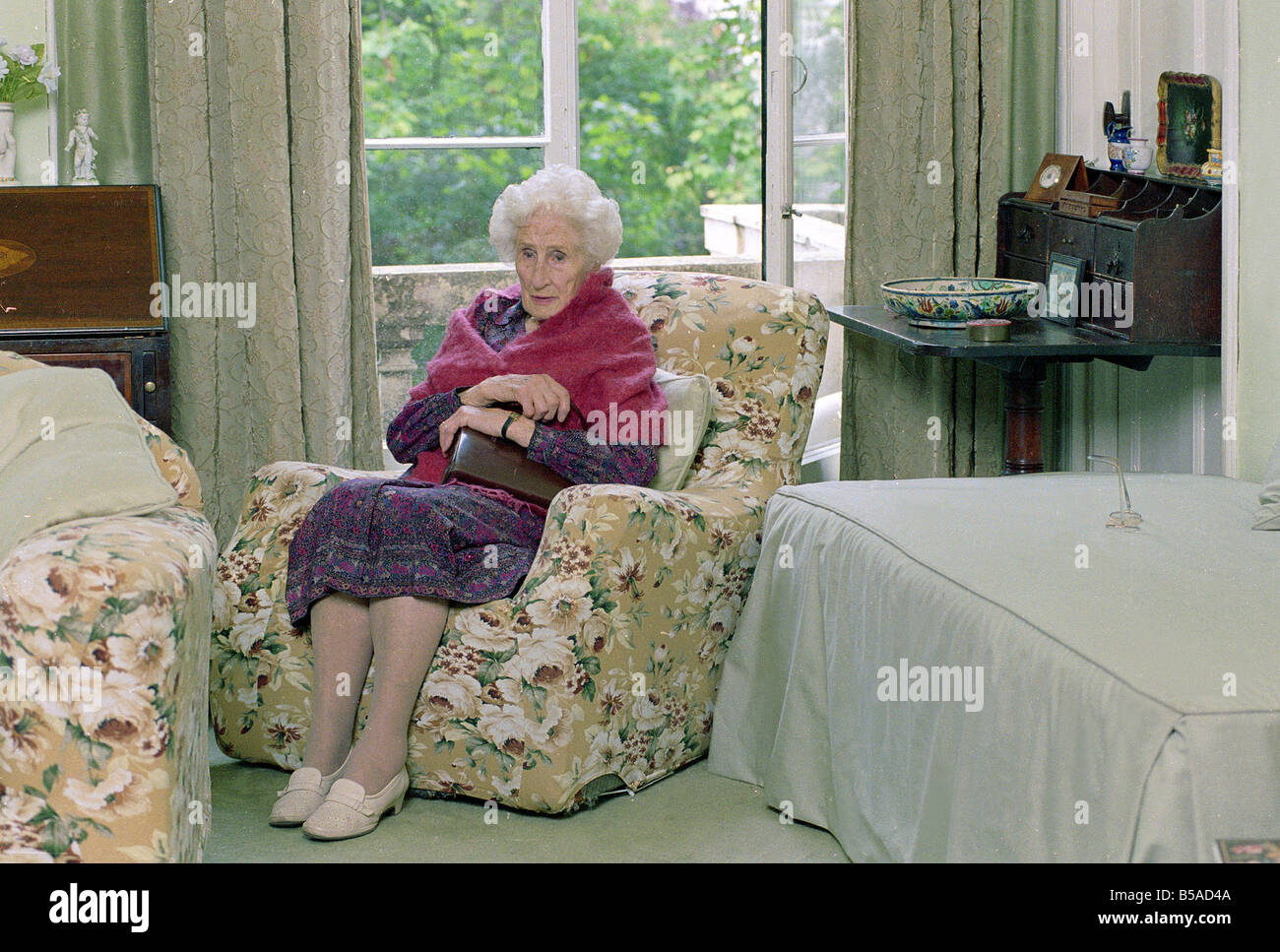 old lady chair antique corner frail holding her handbag people oap oaps