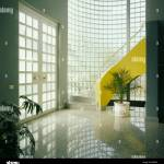 Granite Flooring And Glass Brick Wall In Modern Hall With Yellow Stock Photo Alamy