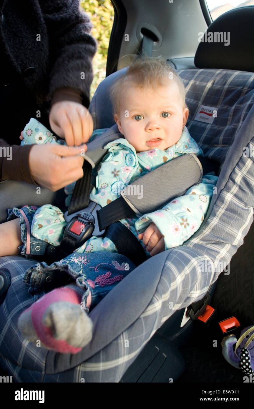 child seat kid baby car in safety safe strapped in strap