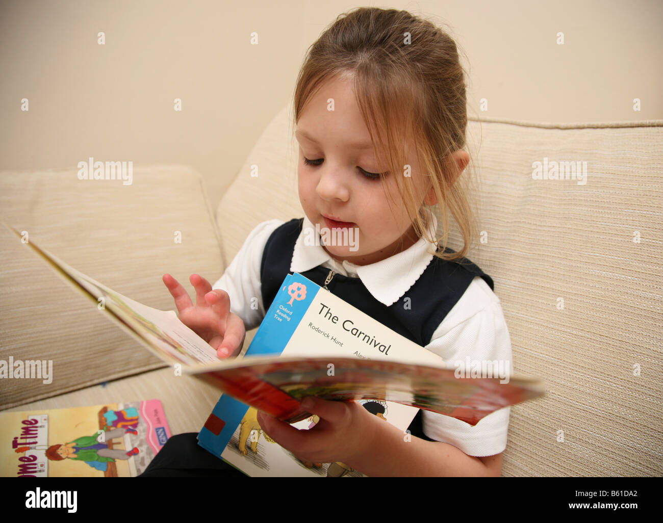 5 Year Old Girl Reading Her Library Books Stock Photo