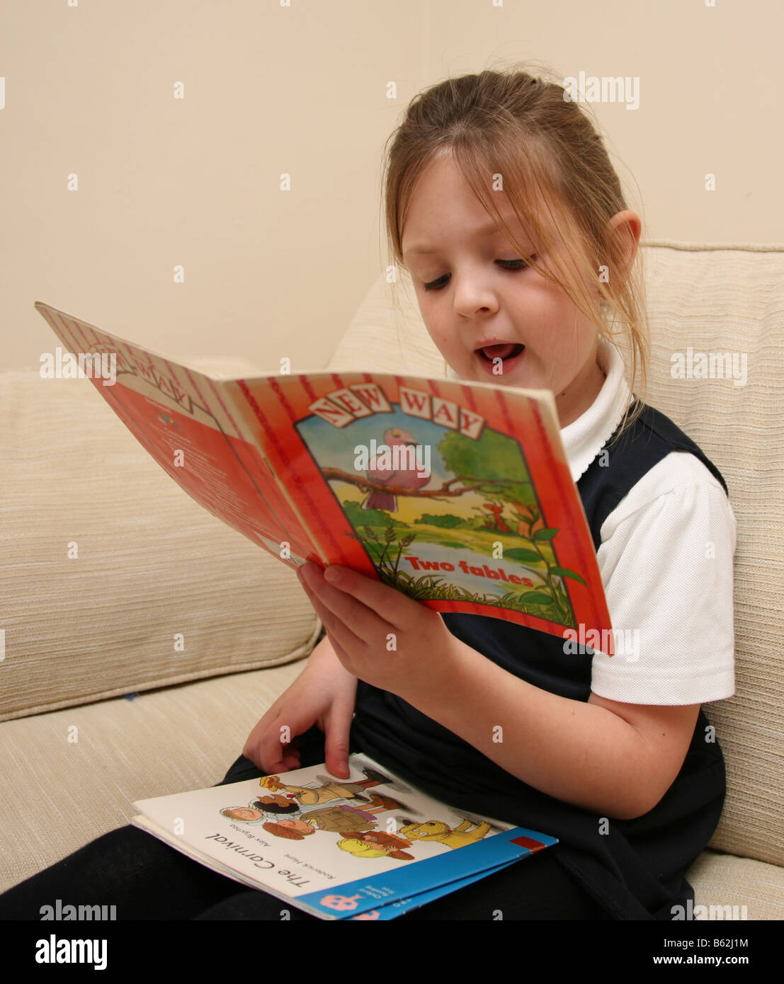 5 Year Old Girl In School Uniform Reading Her Books Loaned