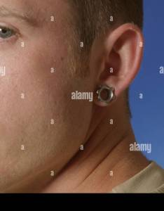Portrait of  young man with ear piercing stock image also photos  images alamy rh