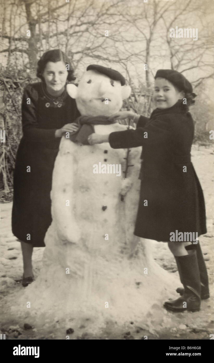 Mother And Child Building A Snowman Together In The 1930s