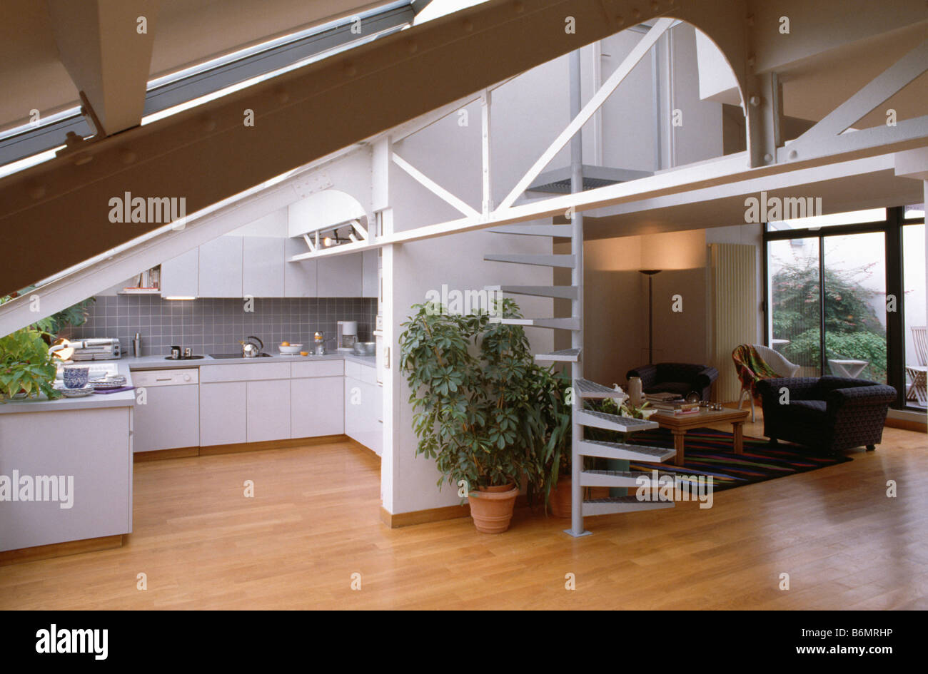 open plan staircase in living room specials with tv wooden flooring and tall houseplant beside spiral stock openplan kitchen modern loft conversion