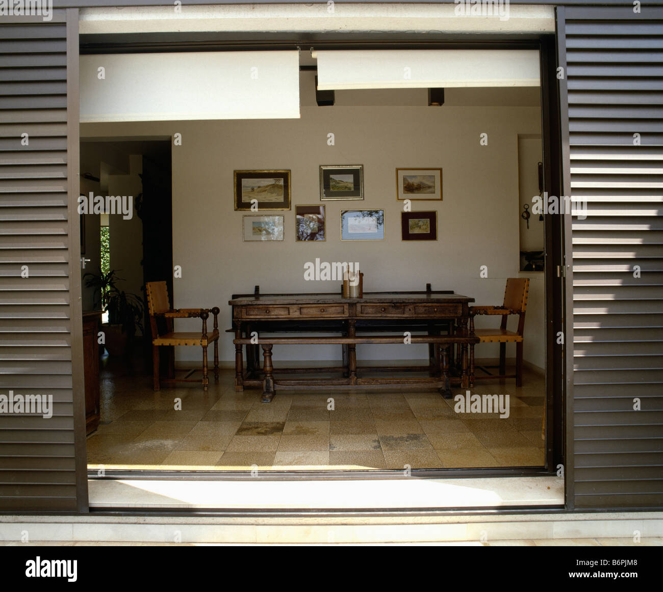 Shutters On Open French Doors With View Of Antique Table