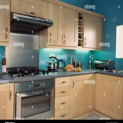 Turquoise Kitchen Appliances Ikea Cabinets Installation Stainless Steel Oven In With Pale Wood