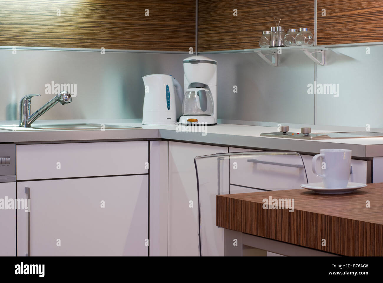 hight resolution of modern white interior kitchen design corner with electrical appliances table chair mug sink and cupboard