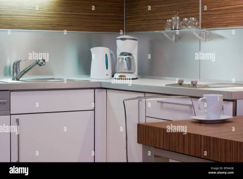 small resolution of modern white interior kitchen design corner with electrical appliances table chair mug sink and cupboard