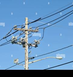 telephone and electric pole with wires insulators cables and street lamp [ 1300 x 953 Pixel ]