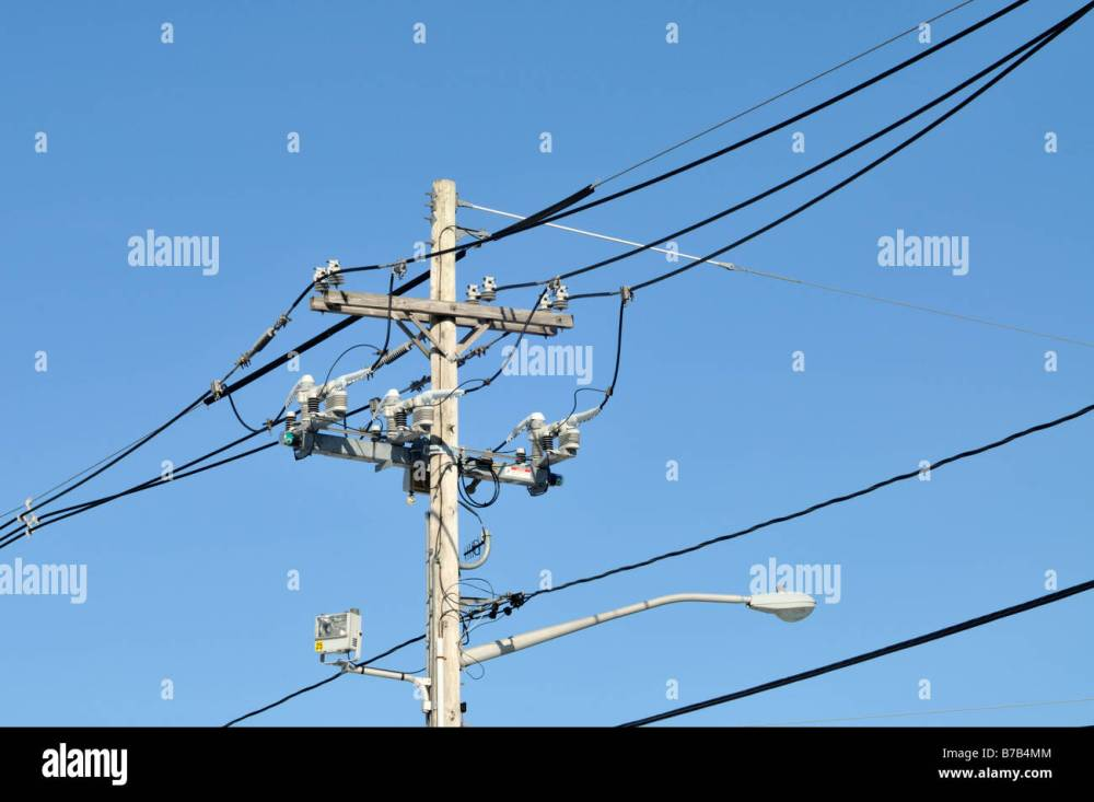 medium resolution of telephone and electric pole with wires insulators cables and street lamp
