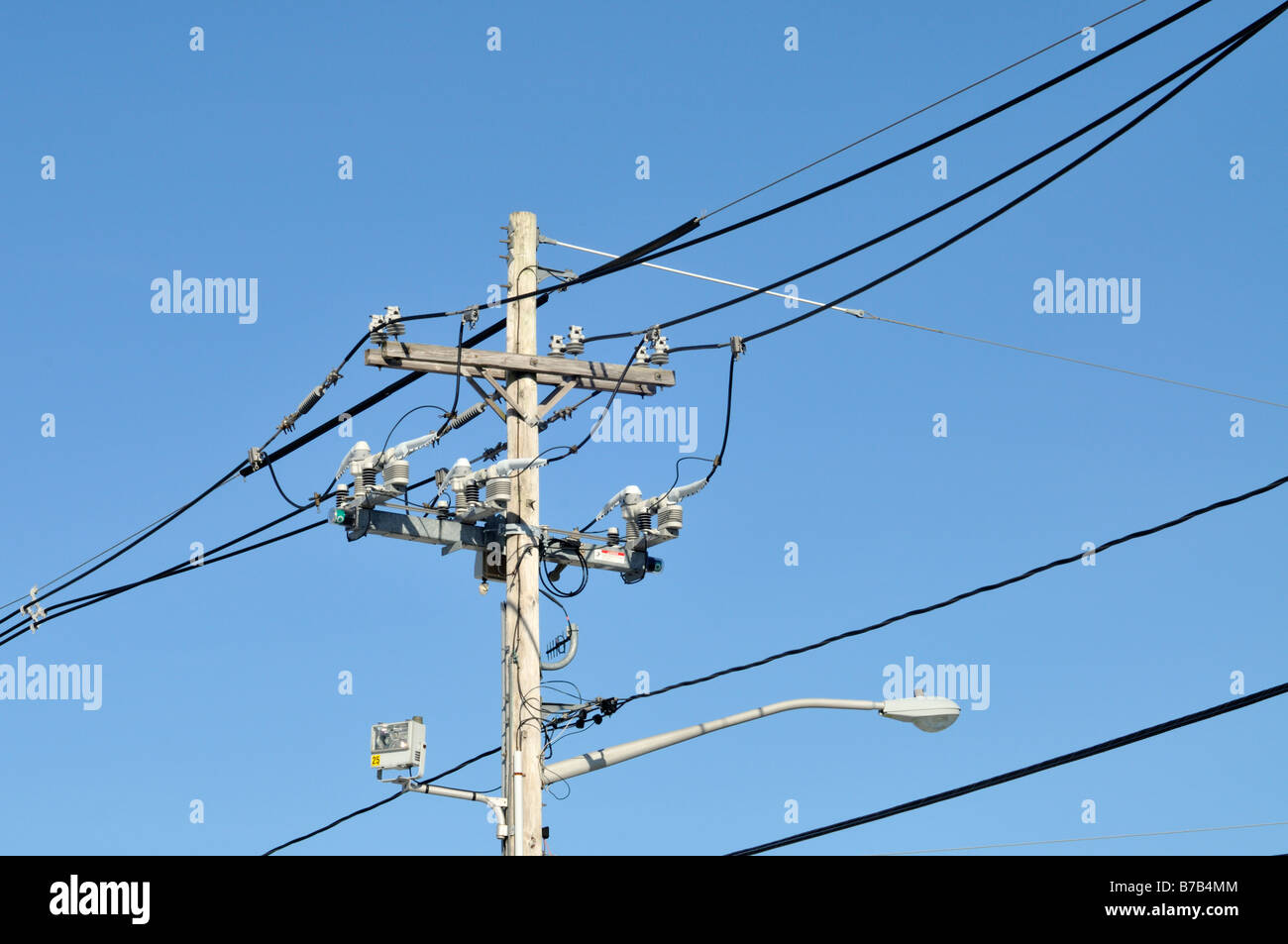 hight resolution of telephone and electric pole with wires insulators cables and street lamp