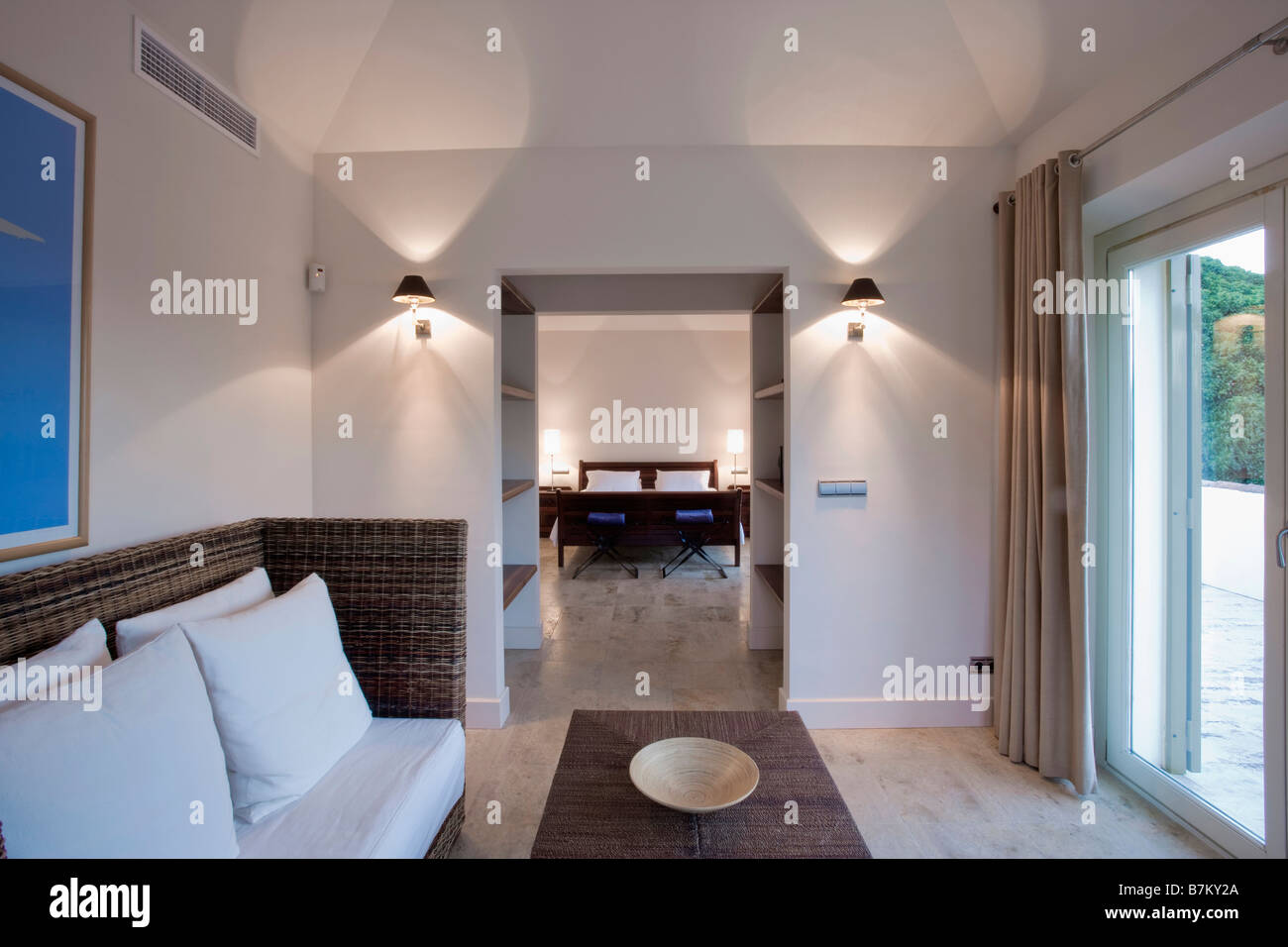wall lamps living room walmart lighted lights on either side of doorway in modern spanish hotel suite