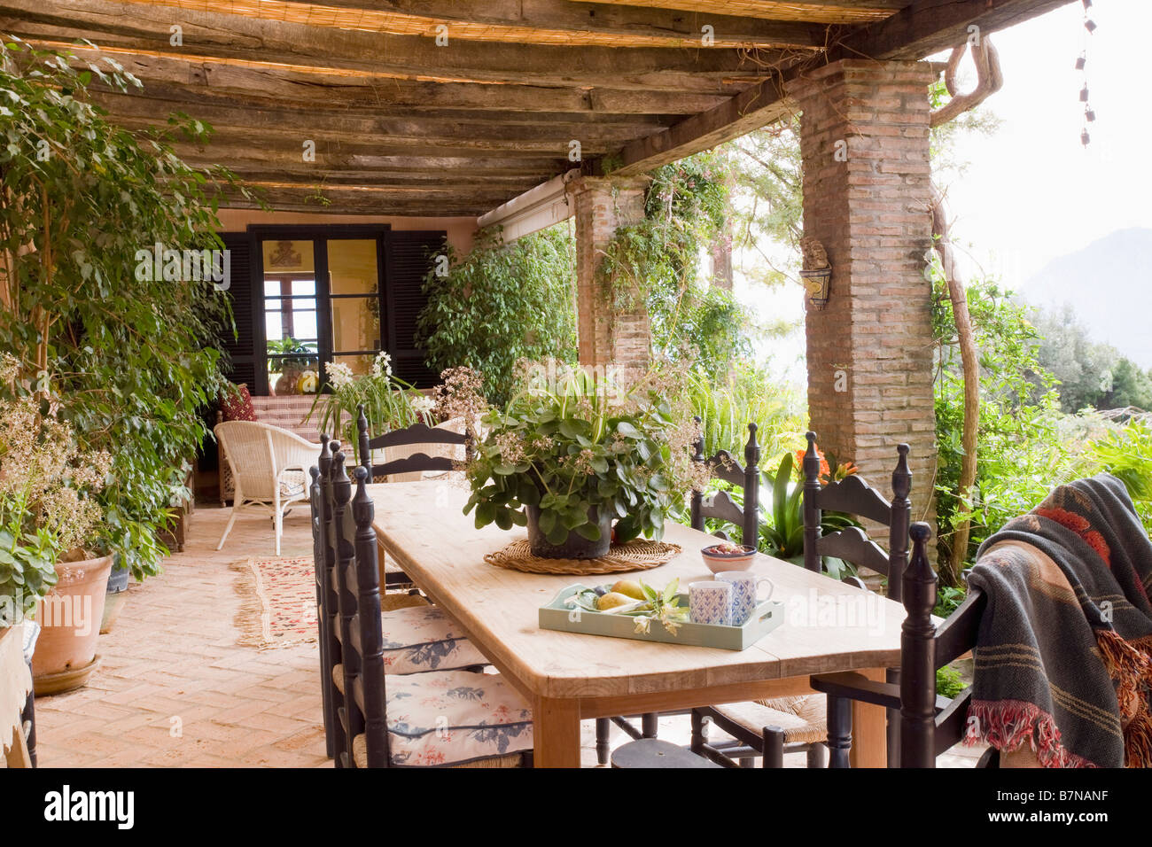 veranda chair design covers at jysk wooden table and carved chairs on of spanish villa