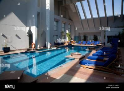 INDOOR / OUTDOOR ROOF SWIMMING POOL DUSIT HOTEL UAE DUBAI ...