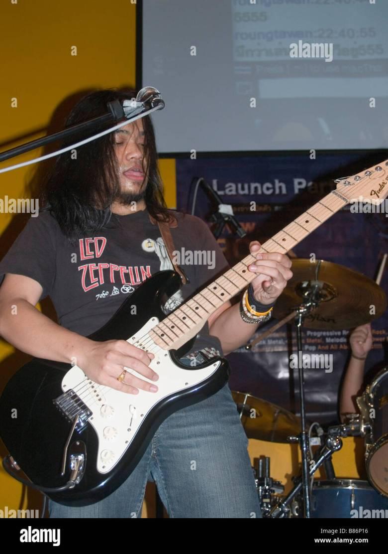 rocker shredding on his flying v guitar in bangkok thailand stock