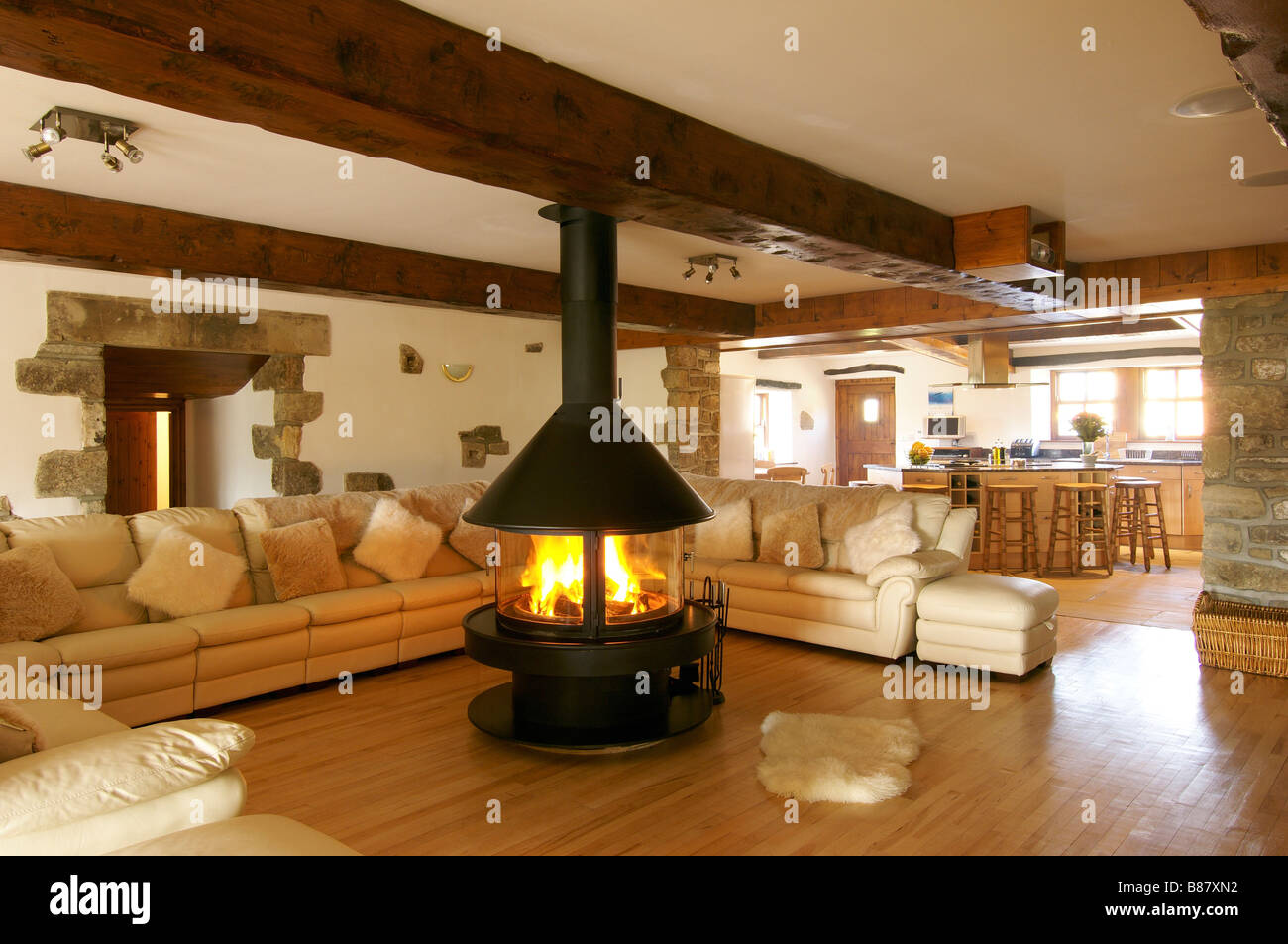 cosy living room with log burner paint options for large corner sofa and central fireplace ...