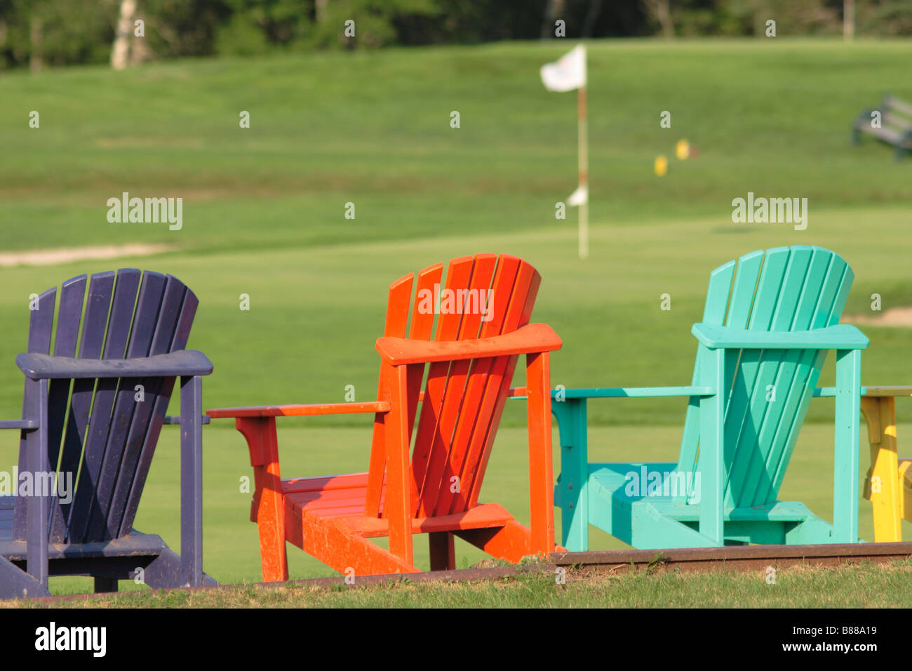 Colorful Wooden Chairs Adirondack Lawn Chairs Stock Photos And Adirondack Lawn