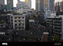 Old and new buildings juxtapose on the hills of Chongqing ...
