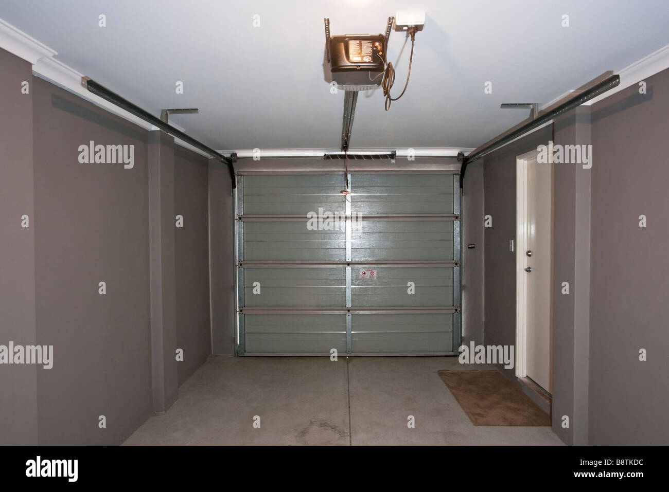 The Inside Of A Garage With An Automatic Garage Door Stock Photo Alamy