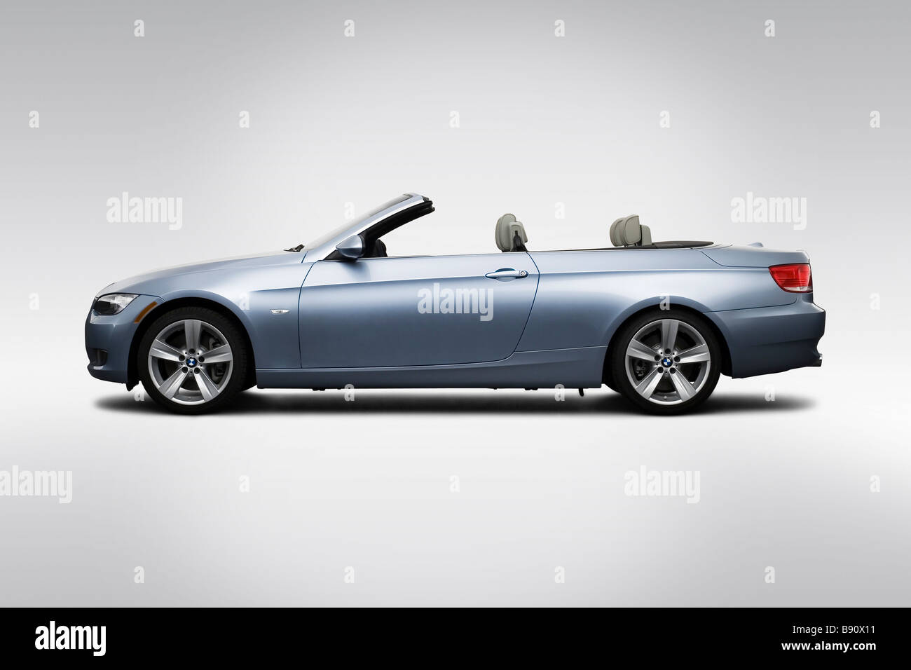 hight resolution of 2009 bmw 3 series 335i in blue drivers side profile stock image