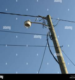 sillouette utility pole and wires and street lamp telephone blue sky background [ 1300 x 1157 Pixel ]