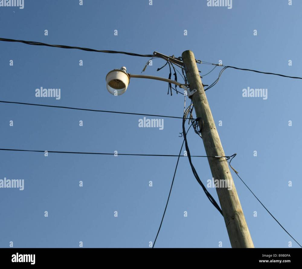 medium resolution of sillouette utility pole and wires and street lamp telephone blue sky background