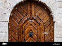 Big arched medieval house door with wicket gate inside it ...