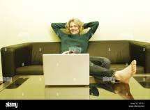 Woman Young Blond Sofa Sitting Feet Table Laptop Happily