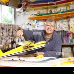 Senior Man Building Model Airplane In Workshop Stock Photo Alamy