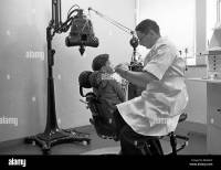 Dental Clinic 1950s. Young boy sits in a chair having his ...