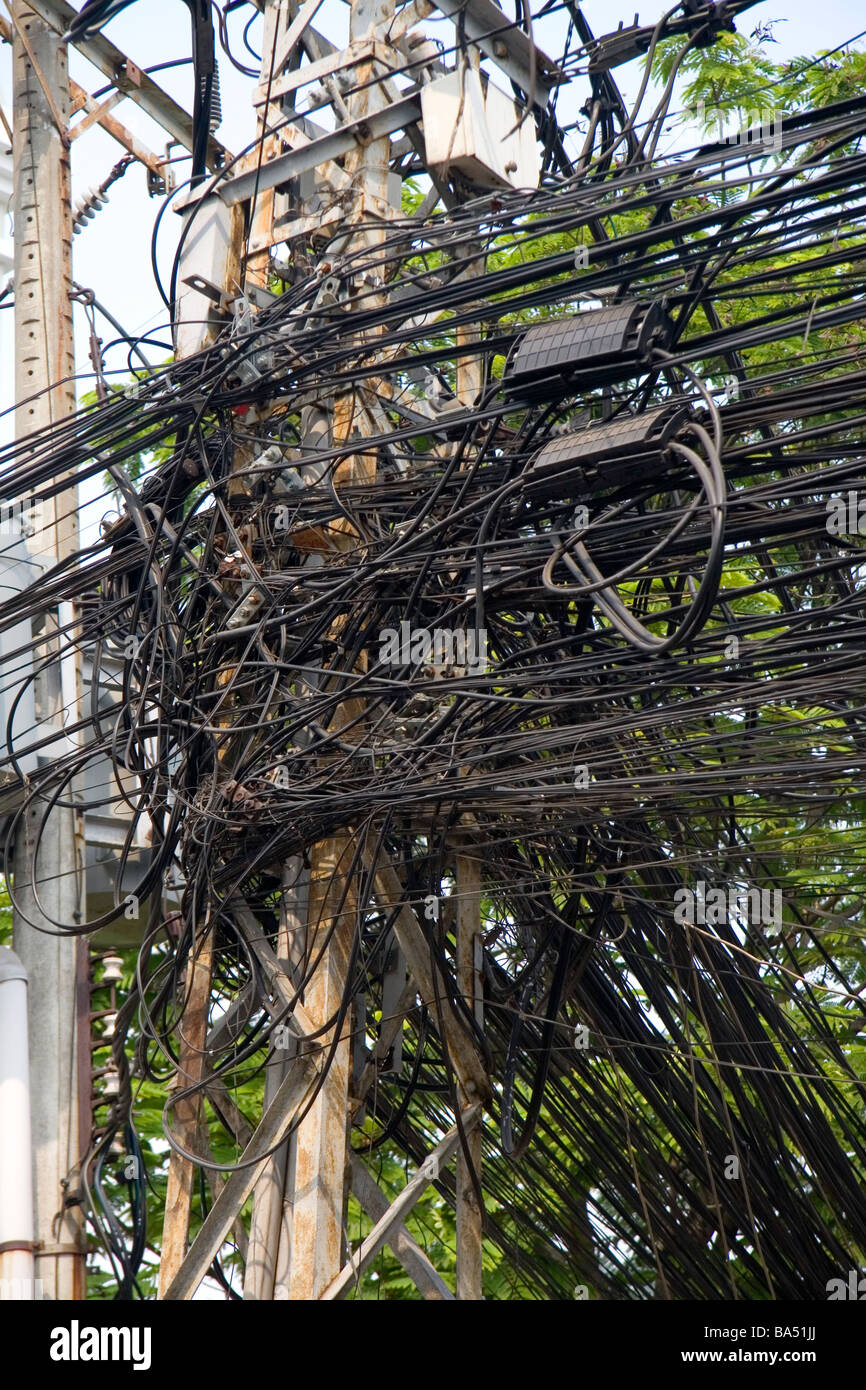 hight resolution of a tangle of telephone wires on a utility pole in ho chi minh city central locking