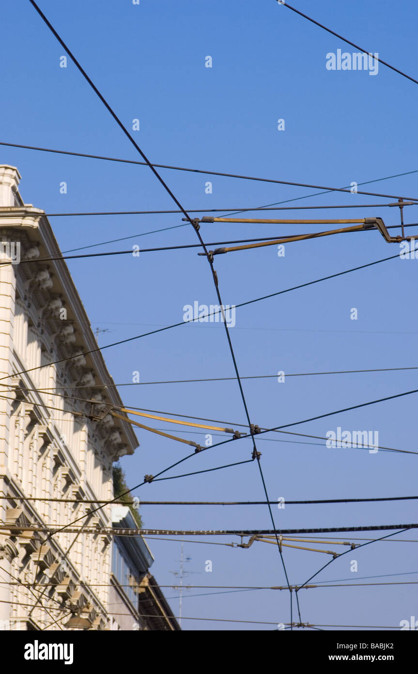 hight resolution of tramway crossing electric cables against a blue sky in milan italy stock image