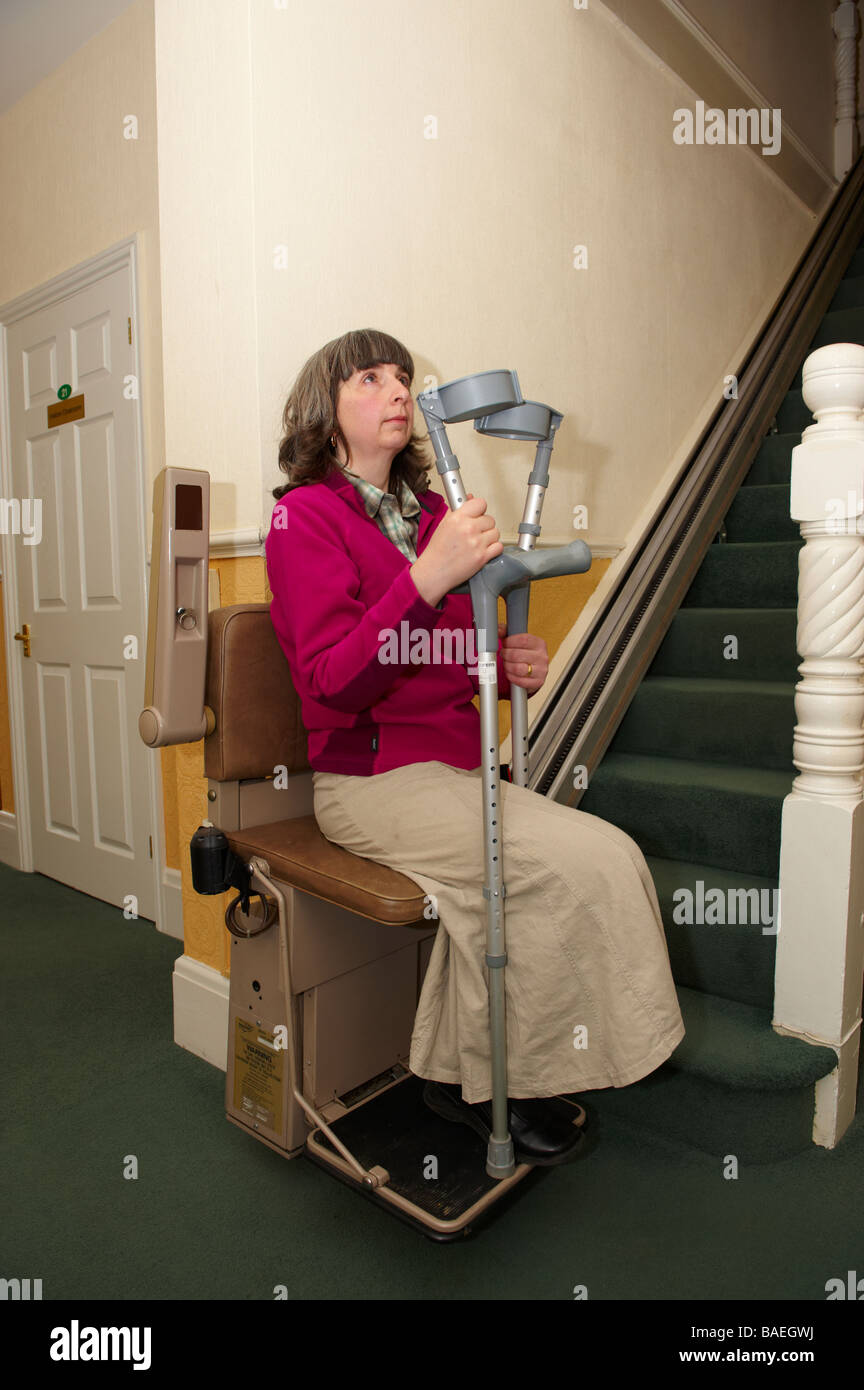 stair chair lifts for seniors cosco retro counter step stool disabled amputee lady in lift with crutches residential home stock photo, royalty free ...
