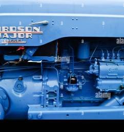 side view of the diesel engine of a blue fordson major tractor stock image [ 1300 x 953 Pixel ]