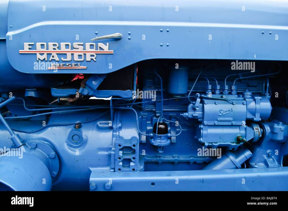 medium resolution of side view of the diesel engine of a blue fordson major tractor stock image