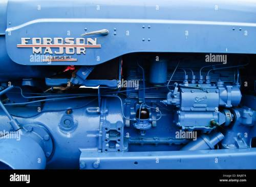 small resolution of side view of the diesel engine of a blue fordson major tractor stock image