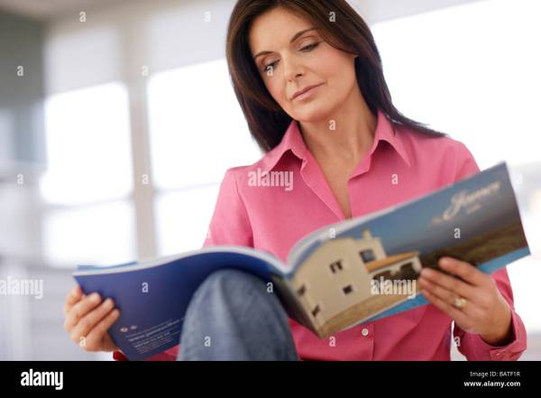 Woman Reading Holiday Brochure Stock 23895587 - Alamy