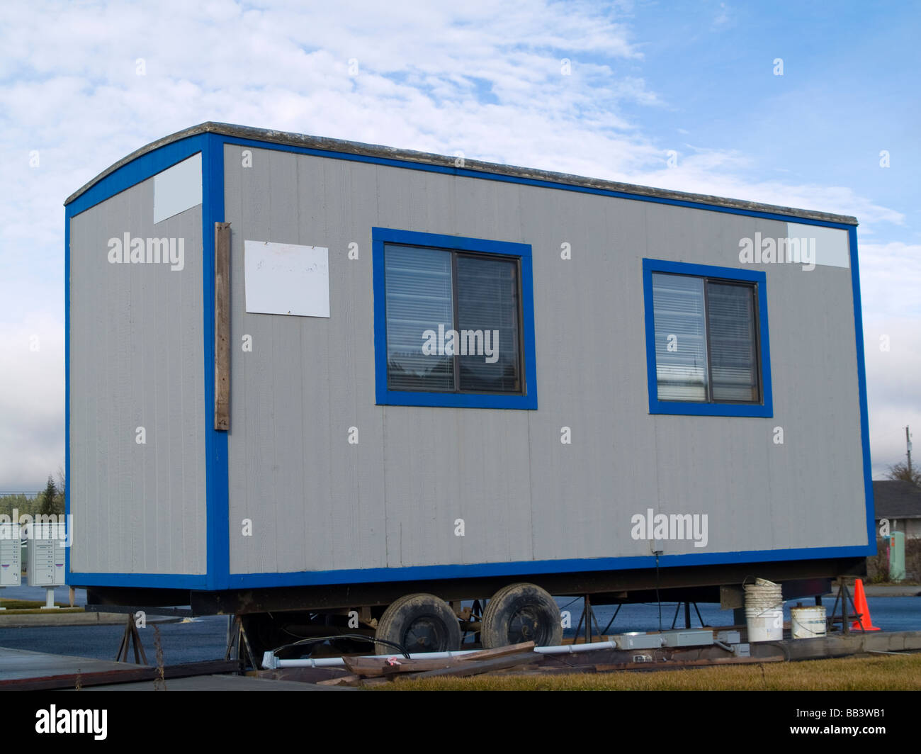 A small portable office on wheels at a construction site