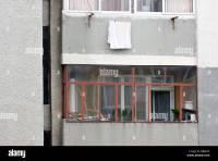 Enclosed balcony of Communist-era concrete apartment house ...