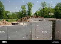 Poured concrete basement walls on new home under ...