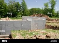 Poured concrete basement walls on new home construction ...