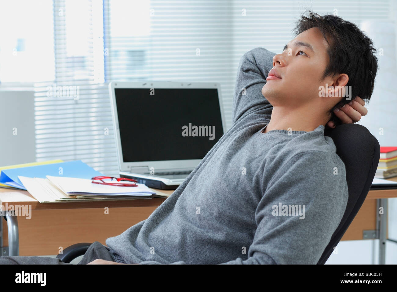office chair leaning to one side hanging stand australia man back in stock photo royalty free