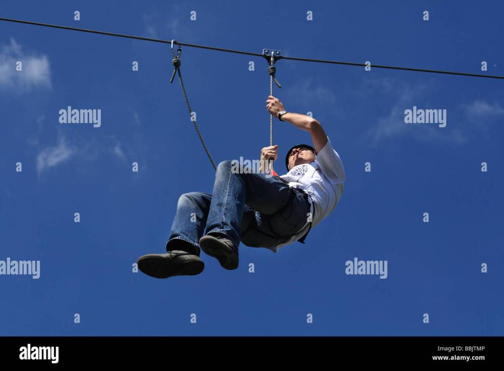 medium resolution of slide down the wire at an adevnture playground stock image