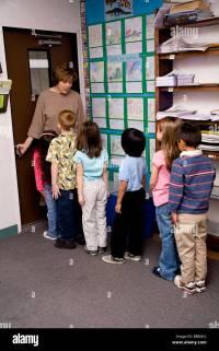 Children Line up at door of class room multi ethnic inter ...